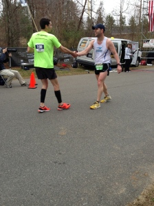 Runners congratulating one another