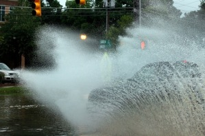When I say I got drenched by cars, I mean like this!  Photo Source: News and Observer